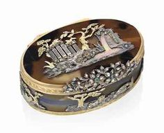 Lot 71 A GERMAN JEWELLED VARI-COLOUR GOLD-MOUNTED HARDSTONE SNUFF-BOX MAKER'S MARK CROWNED - C O, HANAU, CIRCA 1830, WITH TWO FRENCH IMPORT MARKS AND MARKS RESEMBLING THE PARISIAN SECOND CHARGE AND DECHARGE MARKS OF HENRY CLAVEL