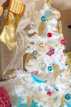 To create a fresh take on Victorian holiday decor, decorate a white Christmas tree with unexpected pink and blue ball ornaments, handmade paper ornaments, festive garlands and shimmery gold feathers >> http://www.diynetwork.com/decorating/how-to-make-traditional-romantic-christmas-decorations/pictures/index.html?soc=pinterest