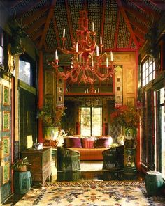 """""""The Tea House"""" which Duquette decorated with an antique Chinese silk temple rug on the floor, Asian antiques and a pagoda chandelier of his own invention.  The ceiling was upholstered between the red lacquer beams with quilted bedspread fabrics which Duquette felt resembled inlaid tiles."""