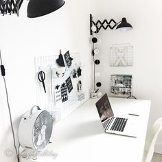I choose a black and white modern color scheme for my new home office. It feels perfect! Organized, clean and not too distracting for serious work.