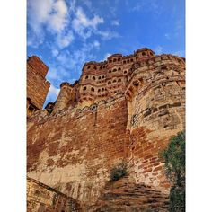 The Mighty Mehrangarh Fort - the Rathore Dynasty revered the Sun God and hence the name Mehrangarh (Mehr meaning sun and Ghar meaning home - Home of the Sun). This is a 500 year old fort dating back to the 14th century, and is an architectural beauty. Overlooking the blue city of Jodhpur, this is a must visit if you love history!  #shankarjohil #travel #jodhpur #mehrangarh #fort #photography #rajasthan Old Fort, Blue City, Jodhpur, 14th Century, My Images, Monument Valley, Dating, Sun, History