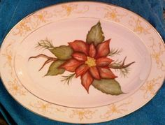 Check out this item in my Etsy shop https://www.etsy.com/listing/215943134/hand-painted-poinsettia-platter