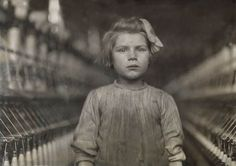 "Lewis Hine's photographs of ""child laborers"" are powerful portraits. This young mill worker, though unidentified, addresses the camera directly and proudly, conveying the full expression of her self."
