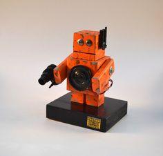 Orange Robot Art, Desktop Sculpture, Handmade Found Object Assemblage. $35.00, via Etsy.