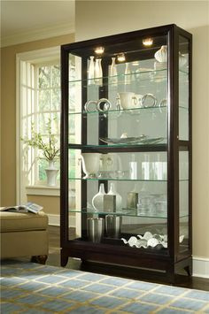 Capture the beauty of this lovely two way sliding door curio. Display decorative items, collectibles or valuables behind these glass doors for everyone to see.
