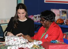 Catherine, Duchess of Cambridge helps to wrap Christmas presents during a visit to the Northside Center for Child Development on December 8, 2014 in New York City. The royal couple are on an official three-day visit to New York with Prince William also due to meet President Barack Obama in Washington D.C today.