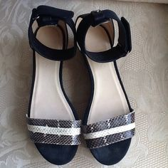 SALE ! JIMMY CHOO SANDALS Sadly I have to Re-Posh the Jimmy Choos that I wanted so badly to fit.  Python Snakeskin print.  Logo. Velcro closure, round toe line. Rubber sole.  Cork wedge.  They are new.  They are wonderful.  The latest Spring to Summer style. Jimmy Choo Shoes Sandals