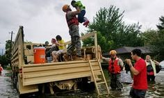 Texas national guard soldiers aid residents in heavily flooded areas.