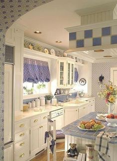 Country kitchen... I really like the blue and white... I used to have that in my kitchen, been going for red, but I sure need simple ways to change it out back and forth easily...curtains, canisters, accents etc.