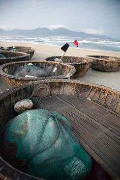 Round, bamboo fishing boats on China Beach at night, Danang, Vietnam