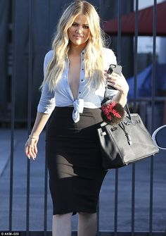 Racy: The 30-year-old Keeping Up With The Kardashians star went braless on her outing...
