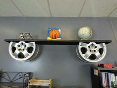 Vintage Furniture reuse car rims into repurposed furniture alloy wheels holders for wooden shelf decor idea - It is a great and unique idea to reuse car rims even if you like cars and all auto accessories. Car Part Furniture, Automotive Furniture, Automotive Decor, Furniture Plans, System Furniture, Bench Furniture, Modern Furniture, Furniture Design, Vintage Furniture