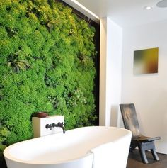 What is a Vertical Garden? A vertical garden is a garden that is grown vertically, rather than a traditional garden, which is grown horizontally on in-ground. Vertical gardens are grown in homes, backyards and cities, where Vertical Green Wall, Vertical Garden Design, Vertical Gardens, Garden Wall Planter, Living Wall Planter, Plant Wall, Plant Decor, Garden Tub Decorating, Decorating Ideas