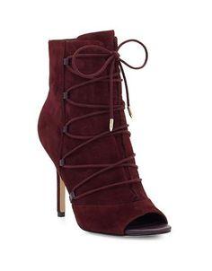 "<ul><li>Exude elegance in these suede lace-up booties</li> <li>Self-covered heel , 4""</li> <li>Suede upper</li> <li>Peep toe</li> <li>Lace-up style</li> <li>Synthetic lining</li> <li>Synthetic sole</li> <li>Imported</li></ul>"