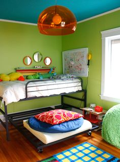 colorful boys room...love the bright ceiling in a contrasting color to the walls and then the bright orange fixture!