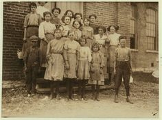 CHILD LABOR:  Fayetteville, Tennessee. Group of spinners at Elk Cotton Mills. According to Lewis, the youngest girl hardly knew her name. 1910