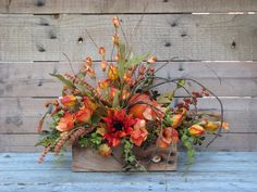 Our harvest floral centerpiece is brimming with the vibrancy of fall colors. Chinese lanterns, alstroemeria, berries and vines are gracefully arranged in a rustic reclaimed wood box. By WreathburyLane Rustic Fall Centerpieces, Thanksgiving Centerpieces, Flower Centerpieces, Floral Decorations, Harvest Decorations, Table Centerpieces, Thanksgiving Flowers, Thanksgiving Table, Fall Flower Arrangements