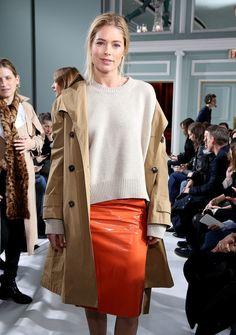 Pencil Skirt Lookbook: Doutzen Kroes wearing Pencil Skirt (1 of 3). Doutzen Kroes gave her look a punch of color with a bright orange pencil skirt.