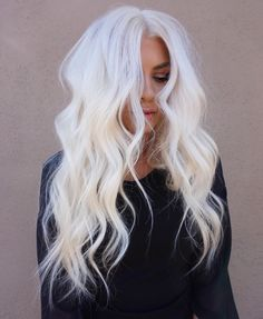 Stunning level 10 icy platinum hair-- looks gorgeous on long, beach-waved, layered hair.