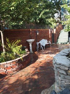 brick raised beds on brick patio with brick walls