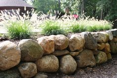 for the berms. Side Yard Landscaping, Landscaping Retaining Walls, Hillside Landscaping, Flagstone Patio, Landscaping With Rocks, Boulder Retaining Wall, Garden Retaining Wall, Sloped Garden, Retaining Wall Construction