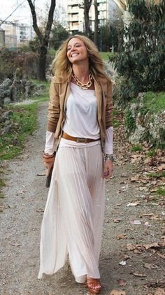 Love the skirt, it is the type you can dress up to go out, or dress down to hang at the beach or mall.