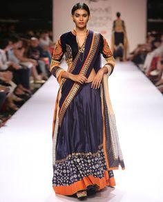 Blue Lehenga sari with golden sequin embellished pallu border. Patterned ikkat…