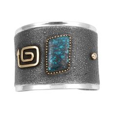 Sterling silver tufa cast bracelet set with gem quality Indian Mountain turquoise and 14k gold...
