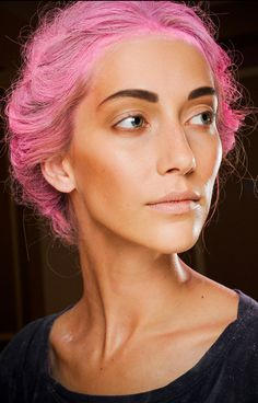 Pink hair (darker shade on darker skin, I think lighter pink is more flattering, but this look would be gorgeous let down in waves)