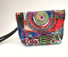 This upcycled, colorful clutch bag is one of a kind, a nice size - 9 wide x 6 tall, and has an interior pocket for your phone. The purse is created by fusing plastic shopping bags and embellishing wth paint, vintage button and fabric remnants. Its a decorative yet functional accessory. Magnetic snap enclosure. Wristlet strap. Reserved. Back to my shop: http://www.etsy.com/shop/itzaChicThing