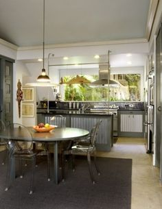 With elements that are unusual to begin with, like metallics, you can make them even more interesting by adding them in surprising places. Think about finishing your cabinetry or the perimeter of your kitchen island in metal.