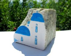 This is an original hand painted Greek rock, coming from Ikaria, the rocky island of longevity & serenity. It's a one of a kind piece. The reliefs of this stone are natural & have guided me to do my subject, which make it exceptional, like it was always meant to be that way.  It's painted in acrylics & is finished with a matt sealant to protect the painting, however like any fine art, it should be handled with care to avoid scratches & stains.  Dimensions (approx.)- 15.00cm ( length ) x…
