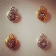 Pretty little silver & gold heart charms with sparkly crystals.  #silver #gold #swarovskielements
