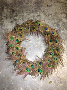 Items similar to Peacock Wreath on Etsy Peacock Wreath, Feather Wreath, Peacock Feathers, Floral Wreath, Peacocks, Floral Flowers, Flower Arrangements, Christmas Crafts, Craft Ideas