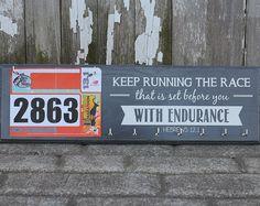 Running Medals Hanger and Bib Rack Holder -  Bible Verse - Keep Running the Race Hebrews 12:1 - Inspirational Medal Hanger. $37.50, via Etsy.
