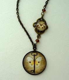 Vintage Key and Butterfly Necklace in Antique Brass. Asymmetrical. Fall Jewelry. $23.00, via Etsy.