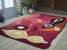 An explosion of colour assaults the eyes as a chilli assaults the mouth. Lots of seeds and pods one of my favourite themes. Hand tufted rug by Annette Turner by