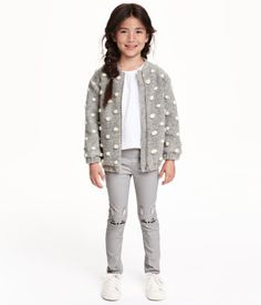 Treggings in thick jersey with an elasticized waistband. Appliqués on knees, mock front pockets, and regular back pockets.