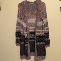 Maurice's Aztec Sweater Maurice's Aztec Sweater. NWOT. Size Large. It seems this runs small Maurices Sweaters Cardigans