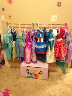 Dress up clothes storage - never thought of towel holder! In different heights . : Dress up clothes storage - never thought of towel holder! In different heights . Dress Up Clothes Storage, Dress Up Closet, Clothing Storage, Dress Clothes, Dress Up Area, Kids Dress Up, Girls Room Organization, Toy Organization, Organizing
