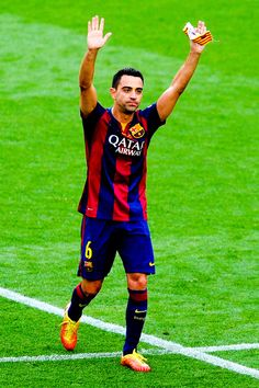 Xavi Hernandez of FC Barcelona knowledges the fans during the La Liga match between FC Barcelona and RC Deportivo de la Coruna at Camp Nou on May 23, 2015 in Barcelona, Catalonia.