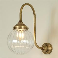 Pentworth Wall Light in Antiqued Brass (Fluted Glass)