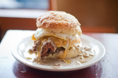 """""""Reggie Deluxe"""" @ Pine State Biscuits: Egg --> Cheese --> Fried Chicken --> Gravy --> Bacon"""