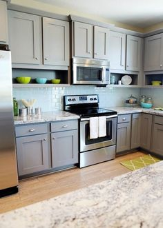 Grey shaker cabinets, open shelves under top cabintes, kitchen, wood floor
