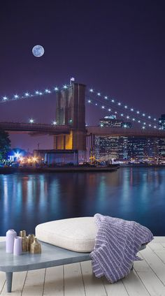 Our Moonlit Brooklyn Bridge Wallpaper Mural is a beautiful design that captures the rather more romantic aspects to this world famous piece of architecture. With a stunning array of colours on display including blues, blacks, purples and yellow tones this design is guaranteed to transform those dull walls into something remarkable. #wallpaper #murals #wallmurals #interior #design #home #homedecor #decor #accentwall #inspiration
