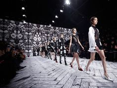 "Viktor & rolf stage for Paris Fashion week 2013, ""rebellious sophistication"" black and white floral backdrop with black and white faux wooden floor runway, black and white collection"