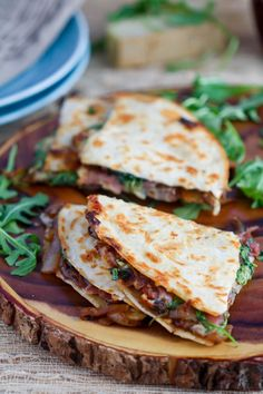 You need this gooey quesadilla filled with caramelized onions, prosciutto, arugula, gruyere and fig jam on your dinner table tonight!