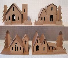Chipboard Buildings is a good way to make an inexpensive Christmas village, and you can customize them how you want!