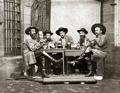 Confederate cavalrymen who were captured during Morgan's Raid photographed eating during their incarceration at Western Penitentiary, Pennsylvania, 1863.