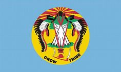 "Flag of Crow Nation: The flag of the Crow tribe is light blue and bears their tribal seal in the center. The current seal bears much symbolism, starting at the bottom with the peace pipe. The pipe was traditionally offered as a first placating step in any significant petition of the Crow people; an offer not to be refused by mortals. Above it is the ""Sacred Medicine Bundle"""